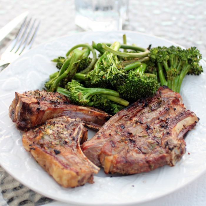 grilled goat chops with roasted broccoli and garlic scapes