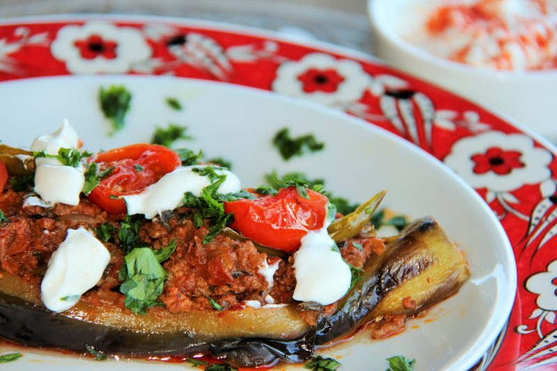 Stuffed Eggplant garnished with garlic yogurt and parsley