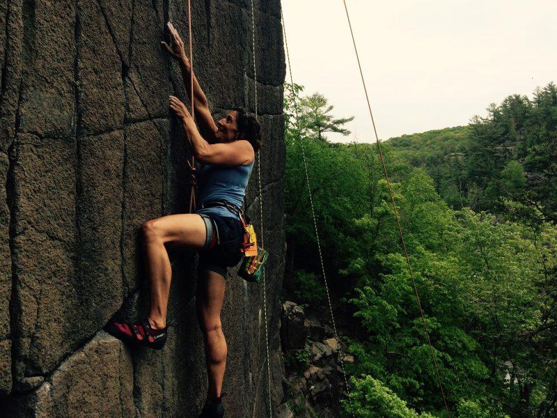 Jeanne rock climbing